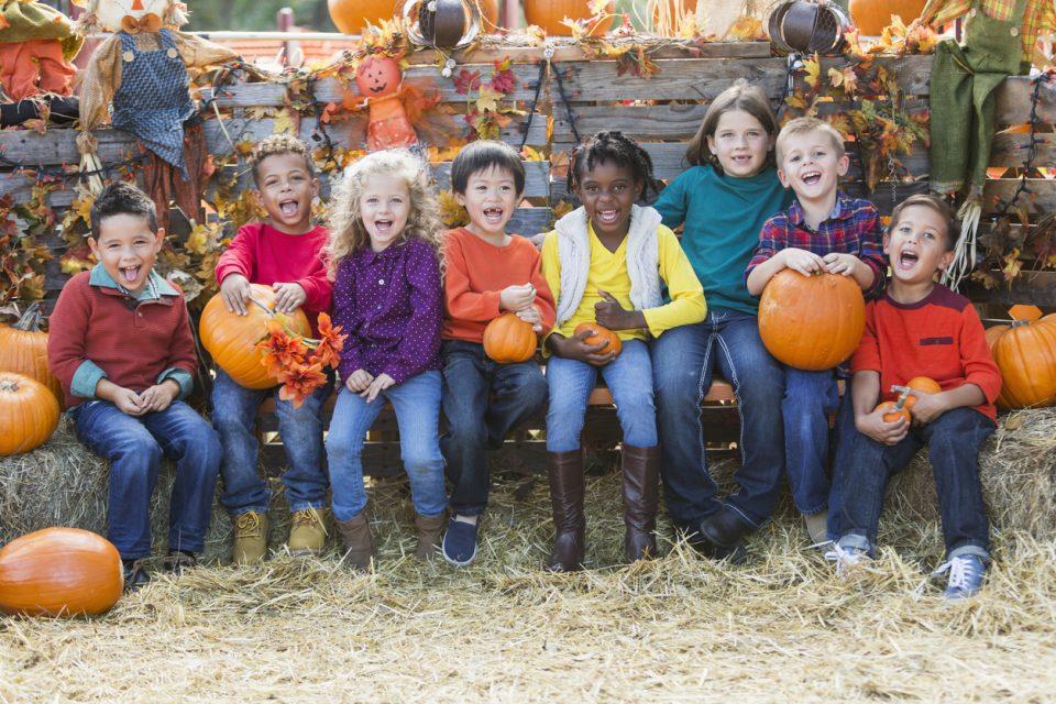 children with pumpkins at pumpkin patch