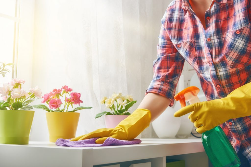 woman doing spring cleaning and decluttering