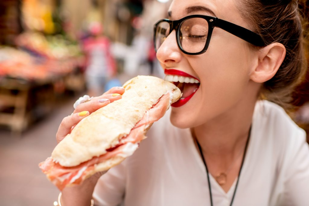 Woman with panini for lunch